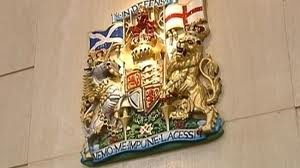 HMRC Coat of Arms on wall.png