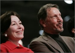 Oracle president Safra Catz and CEO Larry Ellison in USA Today.jpg
