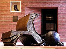 Bill Woodrow - Sitting on History - British Library Sculpture.jpg