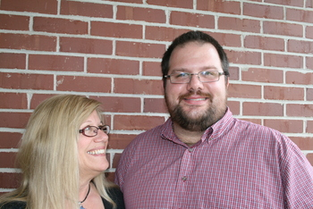 Mother and son Nancy Quinn and Keith Bellew both got their MBAs in part to keep their jobs at Sun once Oracle acquired them. Photo courtesy of the Nashua Telegraph.