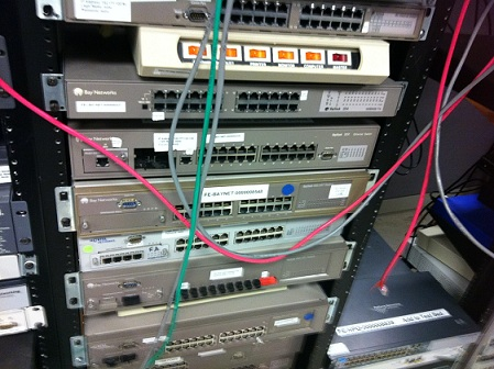A stack of old Bay Networks switches, among other vendors