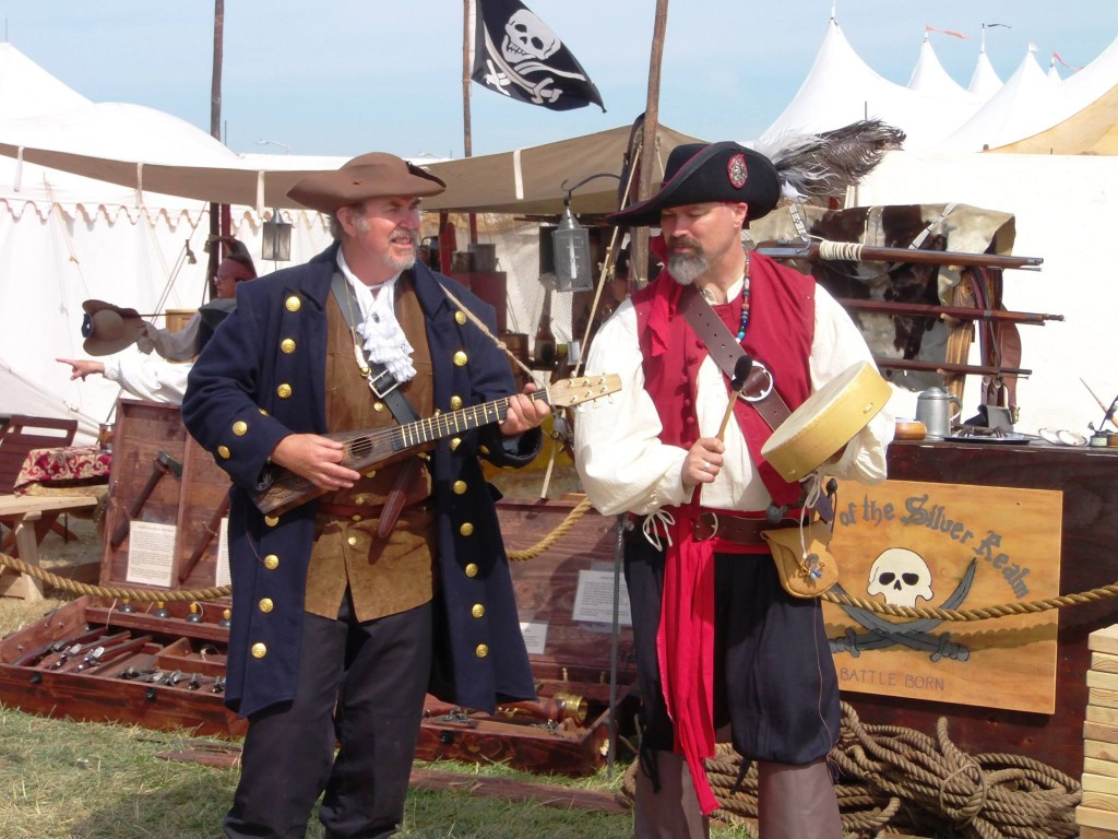 A pair of pirates playing instrumrnts and singing songs for an encampment.