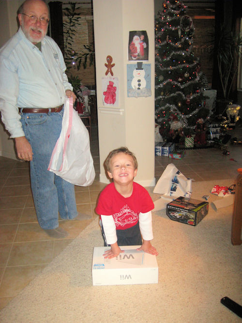 Gregory gets his Wii, while I start picking up the wreckage
