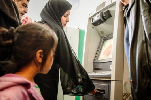 Syrian refugees using ATMs