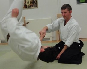Aikido-James-Knight-seated-throwing-opponent.jpg