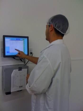 CDF worker enters time and attendance on touch screen.