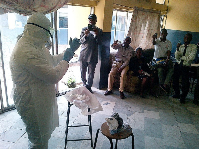 Centers for Disease Control and Prevention team training session on Ebola infection control on August 11, 2014 in Lagos, Nigeria.