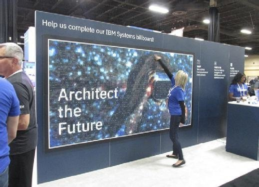 A convention employee examines a mosaic formed from thousands of photos at IBM InterConnect 2017 in Las Vegas earlier this month.