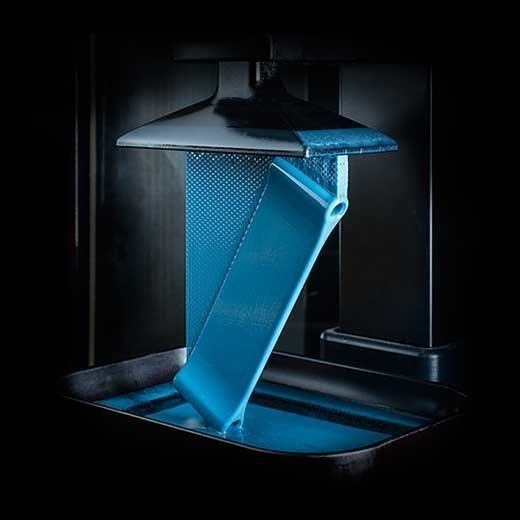 Carbon's CLIP technology prints production quality parts from pools of liquid polymer.