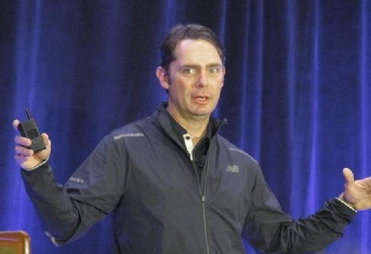 Chris Ladd, executive vice president of global consumer experience at New Balance, speaks at the SIM Boston Technology Leadership Summit