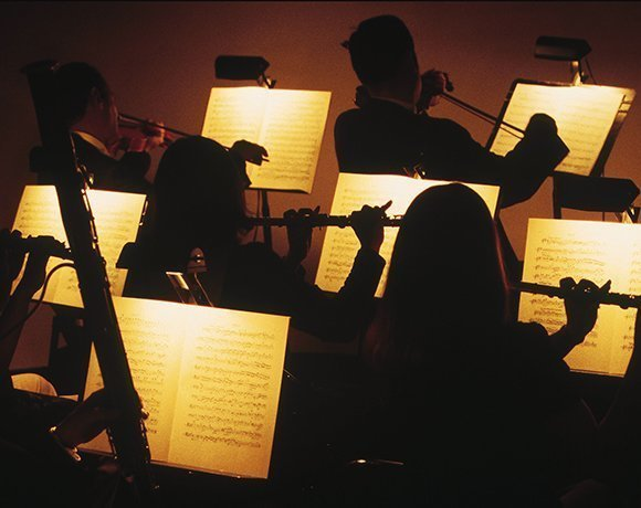 orchestra musicians playing sheet music