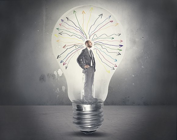 business man in lightbulb with release management ideas
