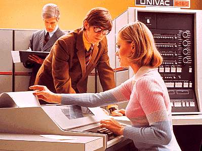 Systems analyst letches over old Univac computer operator.png