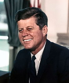 p. 220px-John_F._Kennedy,_White_House_color_photo_portrait.jpg