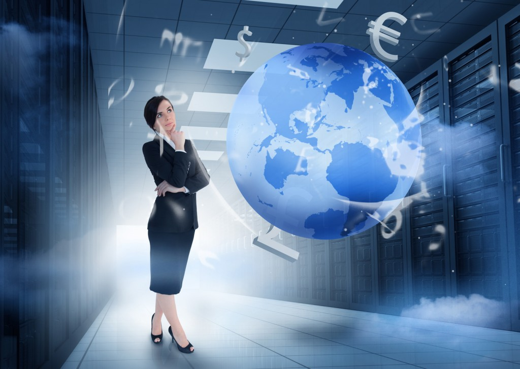 Woman standing in data center while globe twirls in front of her with currency symbols dancing around it.
