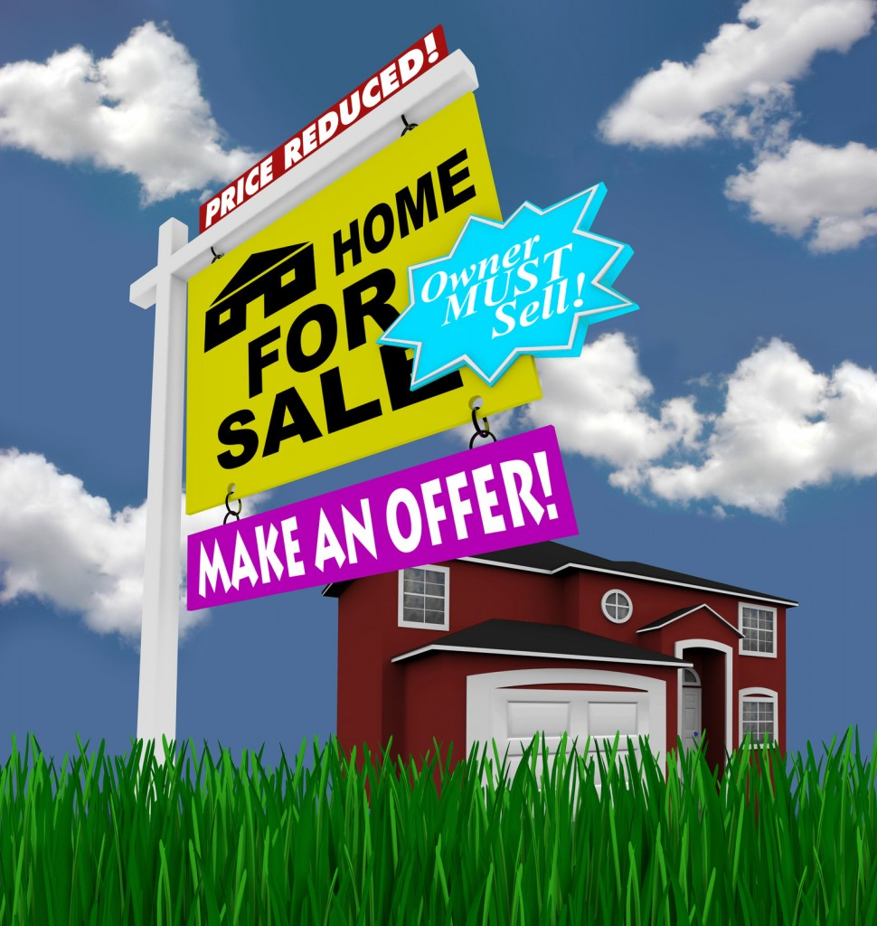 Desperate for sale sign in front of a home.
