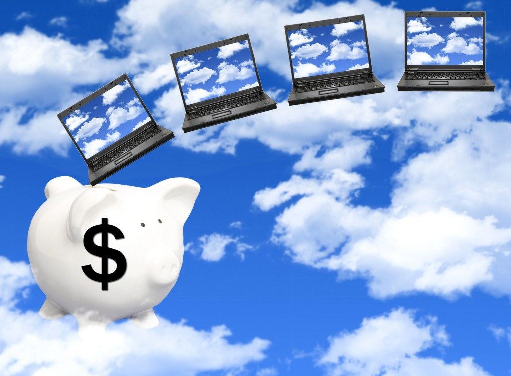 Piggy Bank with dollar sign on it and PCs in sky to symbolize cloud computing