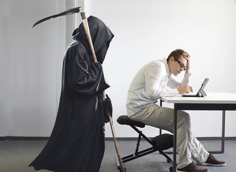 The Grim Reaper Stands Next to a Man Reading E-mail
