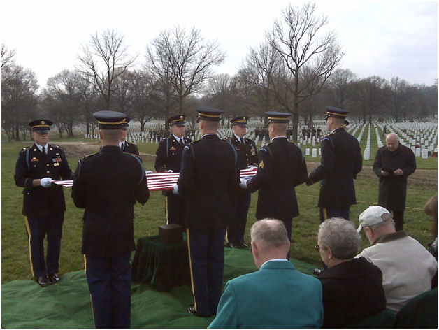 At the gravesite in Arlington, as the Monseignor delivers the burial address.