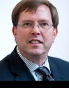 Dr. Guy  Bunker