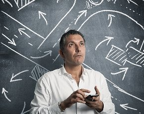 Man in front of chalkboard with directions