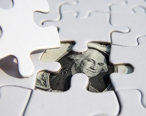 money under puzzle pieces