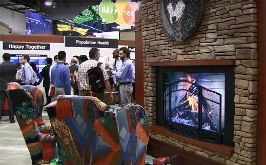 Epic Systems conference booth includes quirky additions, such as a fireplace and large butterfly