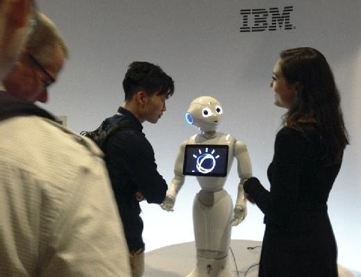 A Pepper robot powered by IBM supercomputer Watson takes questions from conference goers.