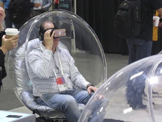 An attendee tries on virtual reality headset at a vendor booth.