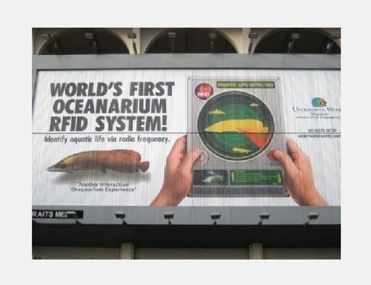 Billboard ad for Underwater World Singapore's RFID system
