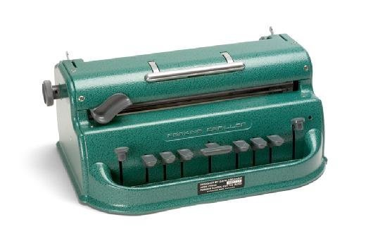 The Perkins Brailler, a machine that types the raised dots of the Braille writing system.