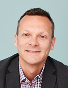 Headshot of Rubrik's Dan Rogers