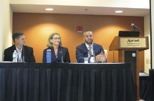 Jascha Franklin-Hodge, CIO at Boston's city government, speaks during a panel discussion at the SIM Boston Technology Leadership Summit on Thursday. Also on the panel are Deborah Corwin Scott, CIO at Worcester Polytechnic Institute and Peter Moreau, senior vice president and CIO at Amica.