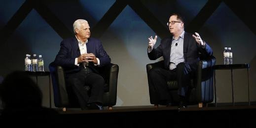 Joseph Tucci, left, chairman and CEO of EMC, sits with Dell founder Michael Dell during an EMC World 2016 session.