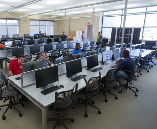 Users work in a computer lab at the university.