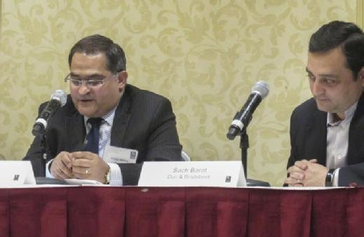 Vinay Mehra speaks during a panel discussion at the MIT Sloan CFO Summit.
