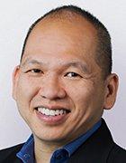 Headshot of Precisely COO Eric Yau